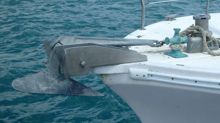 A raised anchor and anchor winch on the deck of a Whitsunday Rent A Yacht charter yacht