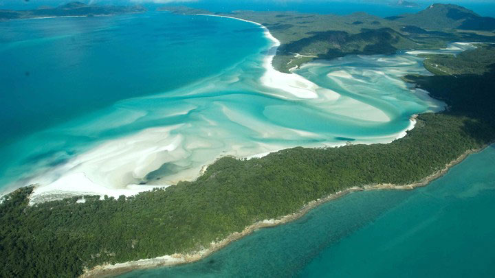 Aerial view of swirling white sandbanks in turquoise waters of Hill Inlet on Whitsunday Island