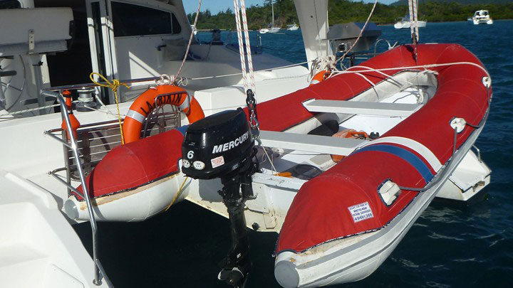 Motor dinghy mounted on the back of a Whitsunday Rent A Yacht charter yacht