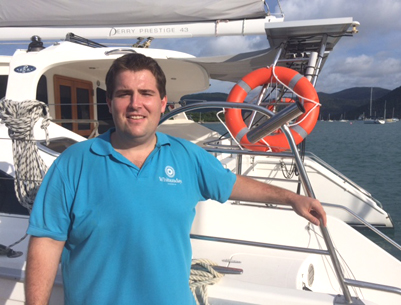 Sales and customer services officer James Middleton on board a Whitsunday Rent a Yacht vessel