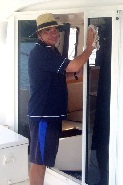 Cleaning supervisor Bruce Lamshed on board a Whitsunday Rent A Yacht charter yacht