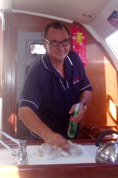 Cleaning supervisor Bruce Lamshed in the galley of a Whitsunday Rent A Yacht charter yacht
