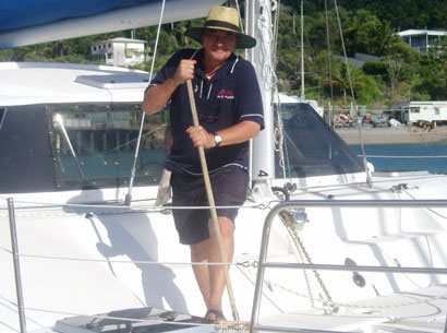 Cleaning supervisor Bruce Lamshed on board a Whitsunday Rent A Yacht sailing catamaran