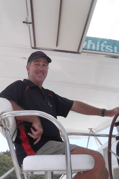 Briefer and relief operations manager Ian Wells on board a Whitsunday Rent A Yacht charter vessel