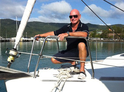Whitsunday Rent A Yacht Briefer Mike Dicker at the prow of a charter yacht