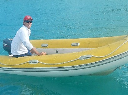 Whitsunday Rent a Yacht operations manager Simon Summerton on board a dinghy