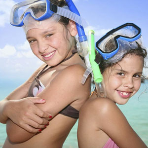 Two girls with snorkels and masks