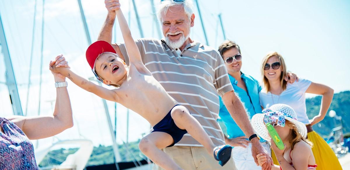 A family on board a Whitsunday Rent a Yacht vessel