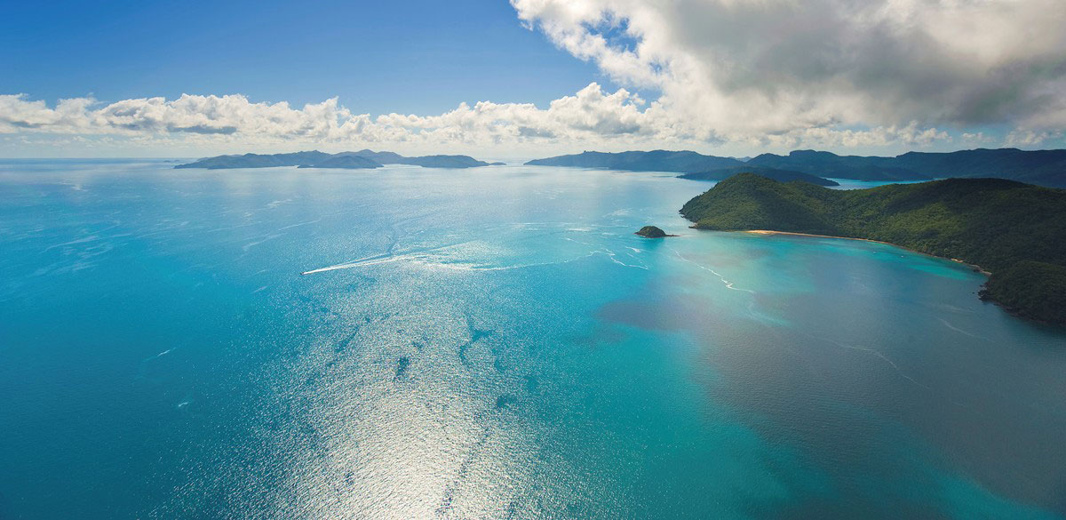 View over tropical turquoise waters and islands of the Whitsundays